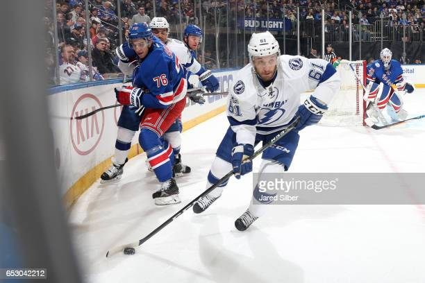 Gabriel Dumont of the Tampa Bay Lightning skates with the puck against Brady Skjei of the New York Rangers at Madison Square Garden on March 13 2017...