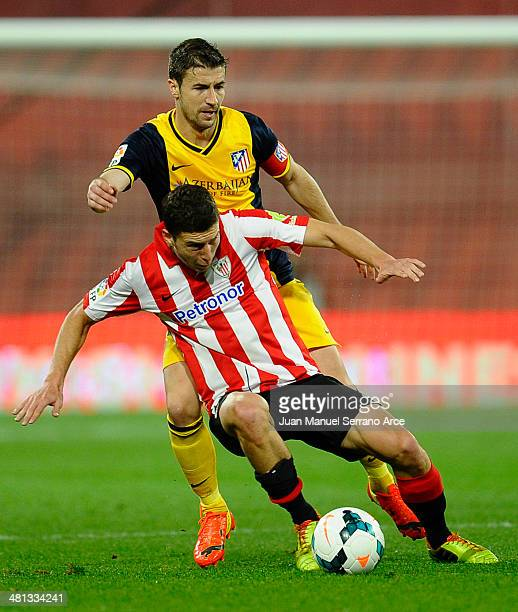 Gabriel Fernandez 'Gabi' of Atletico de Madrid competes for the ball with Oscar De Marcos of Athletic Club during the La Liga match between Athletic...