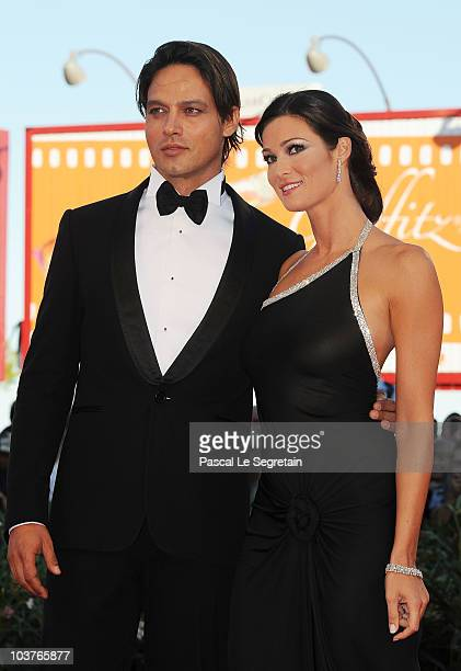 Gabriel Garko and Manuela Arcuri attends the Opening Ceremony and 'Black Swan' premiere during the 67th Venice Film Festival at the Sala Grande...