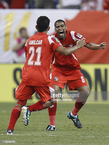 Gabriel Gomez and Amilcar Henriquez of Panama celebrate a first half goal by Luis Tejada while playing Guadeloupe during the 2011 Gold Cup at Ford...
