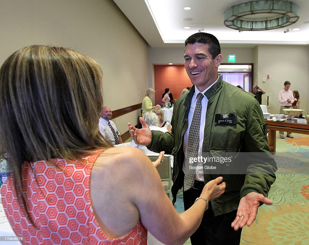 Gabriel Gomez makes his rounds before speaking at a Women for Gomez event at the Seaport World Trade Center, on Wednesday, June 19, 2013.