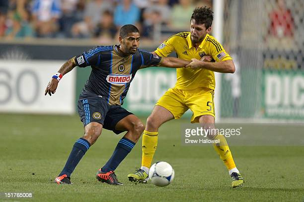 Gabriel Gomez of the Philadelphia Union and Danny O'Rourke of the Columbus Crew battle for the ball at PPL Park on August 29 2012 in Chester...