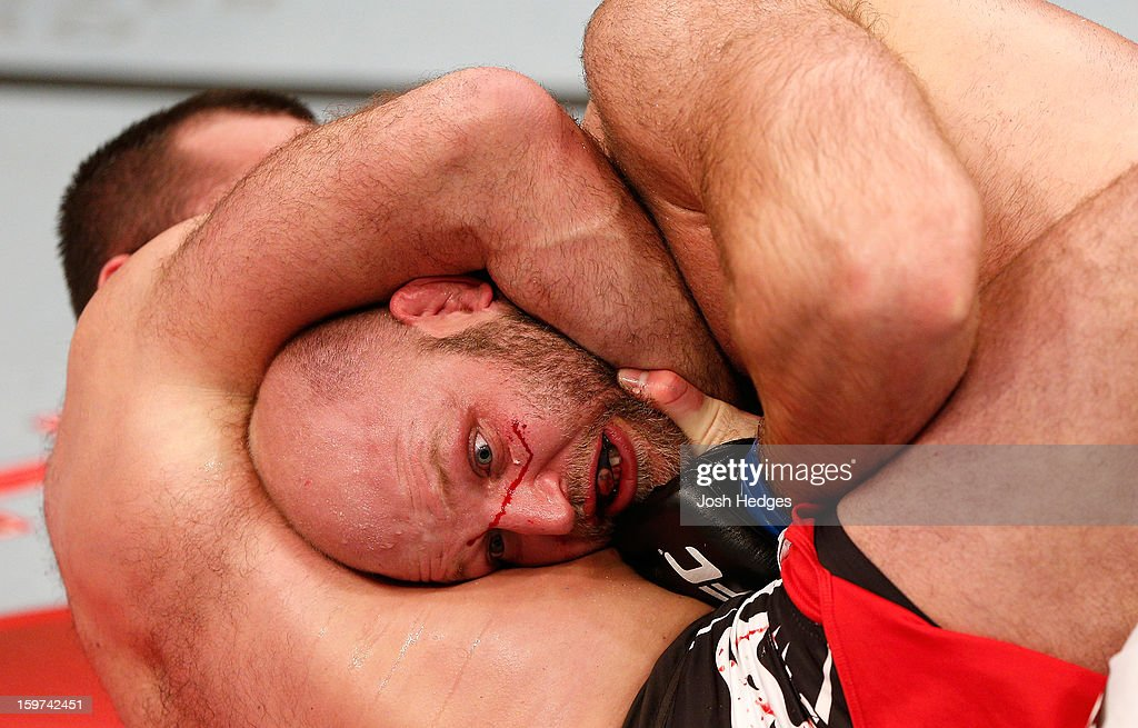 <a gi-track='captionPersonalityLinkClicked' href=/galleries/search?phrase=Gabriel+Gonzaga&family=editorial&specificpeople=4254256 ng-click='$event.stopPropagation()'>Gabriel Gonzaga</a> secures a guillotine choke submission against Ben Rothwell in their heavyweight fight at the UFC on FX event on January 19, 2013 at Ibirapuera Gymnasium in Sao Paulo, Brazil.