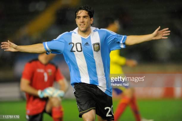Gabriel Hauche of Argentina celebrates a scored goal during a friendly soccer match against Ecuador at Jose Maria Minella stadium on April 20 2011 in...