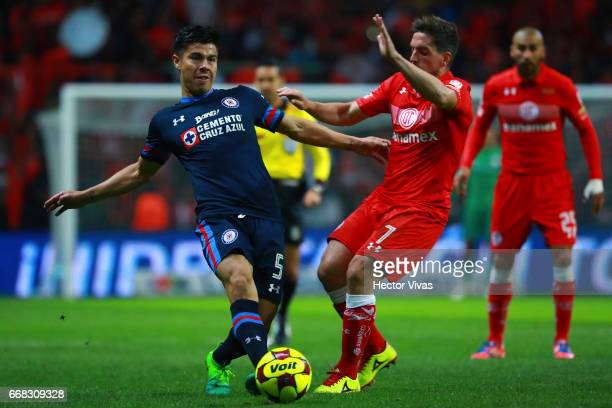 Gabriel Hauche of Toluca struggles for the ball with Francisco Silva of Cruz Azul during the 10th round match between Toluca and Cruz Azul as part of...