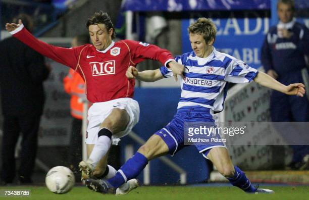 Gabriel Heinze of Manchester United clashes with Kevin Doyle of Reading during the FA Cup sponsored by EON Fifth Round Replay match between Reading...
