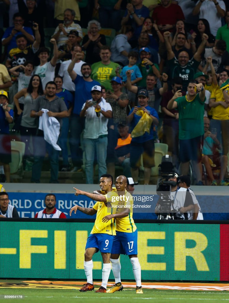 Gabriel Jesus (L) and Fernandinho of Brazil celebrate their thirth goal during the match between Brazil and Chile for the 2018 FIFA World Cup Russia Qualifier at Allianz Parque Stadium on October 10, 2017 in Sao Paulo, Brazil.
