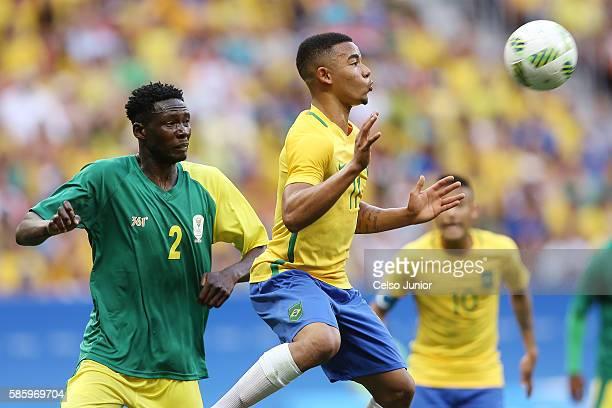 Gabriel Jesus Brazil ans Mathoho Mulomowandau South Africa at Mane Garrincha Stadium on August 4 2016 in Brasilia Brazil