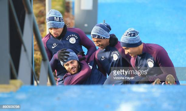 Gabriel Jesus Fernandinho and Danilo carry Bernardo Silva out to training at Manchester City Football Academy on December 12 2017 in Manchester...