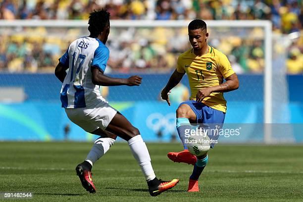 Gabriel Jesus of Brazil and Alberth Elis of Honduras in action during the Men's Semifinal Football match between Brazil and Honduras at Maracana...