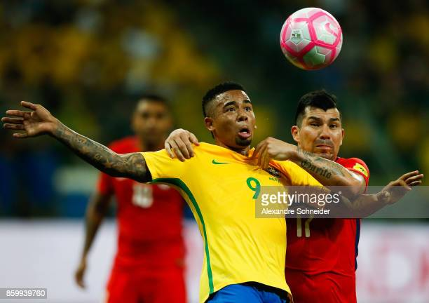 Gabriel Jesus of Brazil and Gary Medel of Chile in action during the match between Brazil and Chile for the 2018 FIFA World Cup Russia Qualifier at...