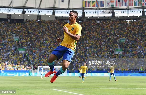 Gabriel Jesus of Brazil celebrates scoring his goal during the Olympic Men's semi final match between Brazil and Honduras at Maracana Stadium on...