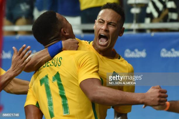 TOPSHOT Gabriel Jesus of Brazil celebrates with teammate Neymar his goal against Denmark during the Rio 2016 Olympic Games mens first round Group A...