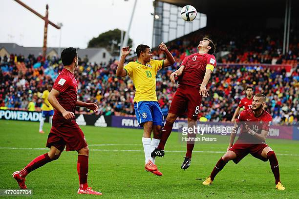 Gabriel Jesus of Brazil competes with Chico Ramos of Portugal for the ball during the FIFA U20 World Cup New Zealand 2015 quarter final match between...