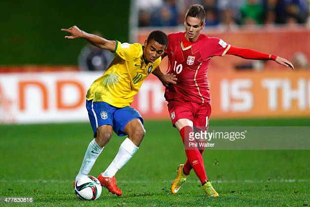 Gabriel Jesus of Brazil holds bask Mijat Gacinovic of Serbia during the FIFA U20 World Cup Final match between Brazil and Serbia at North Harbour...