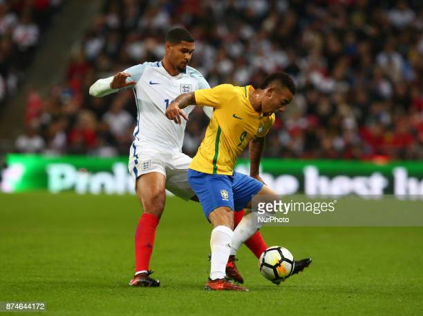 Gabriel Jesus of Brazil holds of England's Ruben LoftusCheek during International Friendly match between England and Brazil at Wembley stadium London...