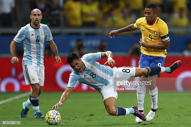 Gabriel Jesus of Brazil struggles for the ball with Guido Pizarro of Argentina during a match between Brazil and Argentina as part of 2018 FIFA World...