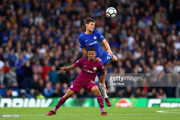 Gabriel Jesus of Manchester City and Andreas Christensen of Chelsea battle for possession in the aiir during the Premier League match between Chelsea...