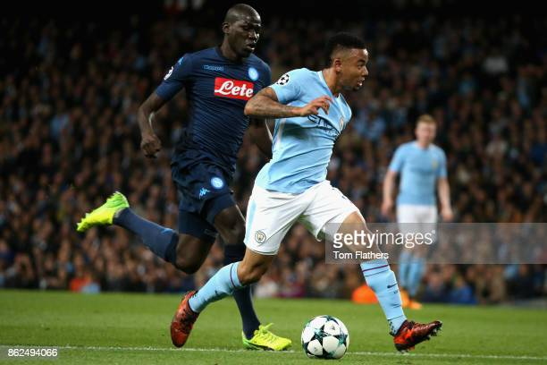 Gabriel Jesus of Manchester City and Kalidou Koulibaly of SSC Napoli battle for possession during the UEFA Champions League group F match between...