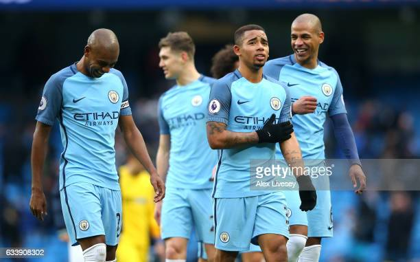 Gabriel Jesus of Manchester City and team mates celebrate after the full time whistle during the Premier League match between Manchester City and...