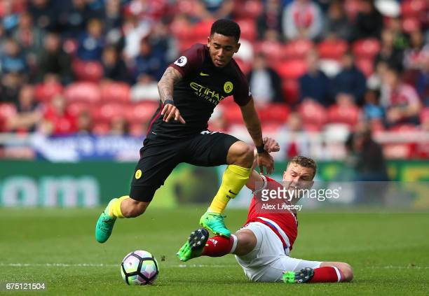 Gabriel Jesus of Manchester City attempts to escape the challenge of Ben Gibson of Middlesbrough during the Premier League match between...