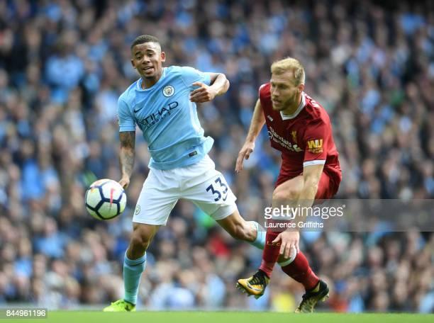 Gabriel Jesus of Manchester City battles with Ragnar Klavan of Liverpool during the Premier League match between Manchester City and Liverpool at...