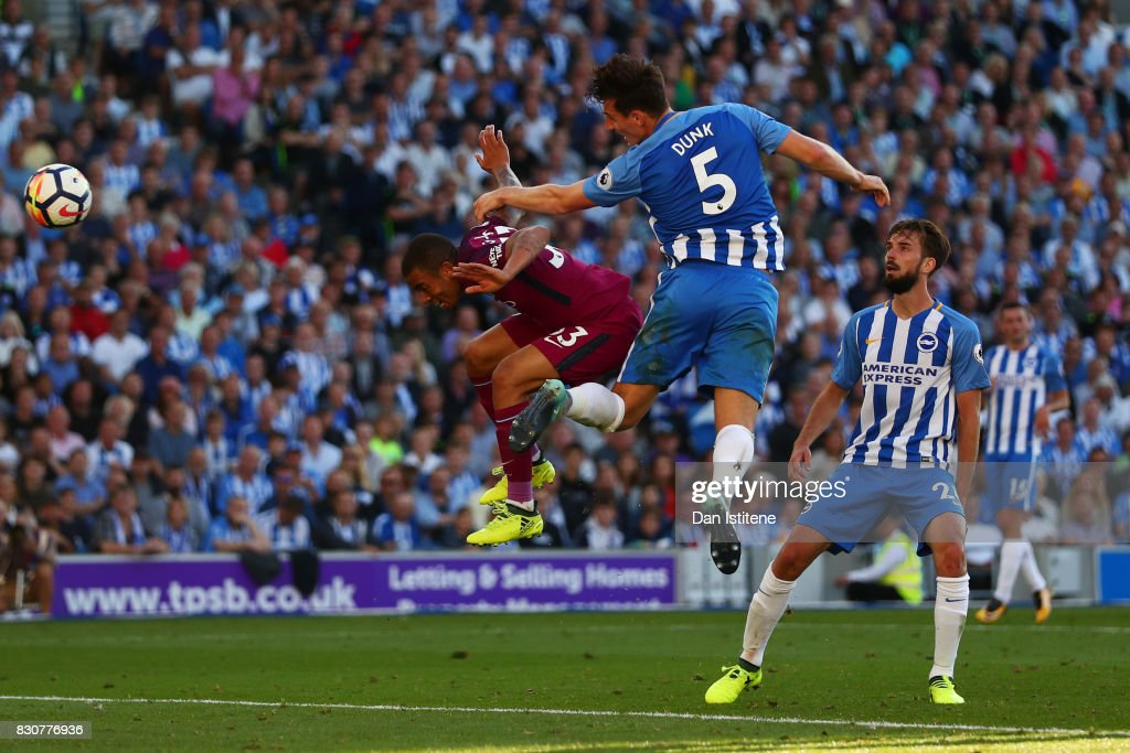 Gabriel Jesus of Manchester City beats Lewis Dunk of Brighton & Hove Albion to the ball to scores his sides second goal during the Premier League match between Brighton and Hove Albion and Manchester City at the Amex Stadium on August 12, 2017 in Brighton, England.