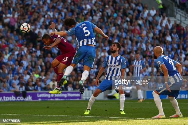 Gabriel Jesus of Manchester City beats Lewis Dunk of Brighton Hove Albion to the ball to scores his sides second goal during the Premier League match...