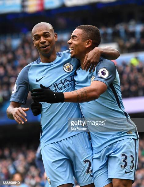 Gabriel Jesus of Manchester City celebrates scoring his sides first goal with Fernandinho of Manchester City during the Premier League match between...