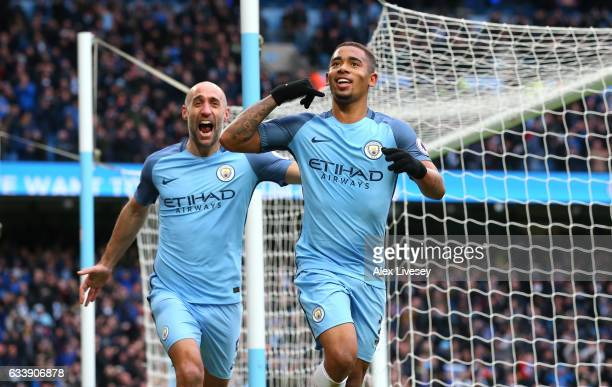 Gabriel Jesus of Manchester City celebrates scoring his sides second goal with Pablo Zabaleta during the Premier League match between Manchester City...