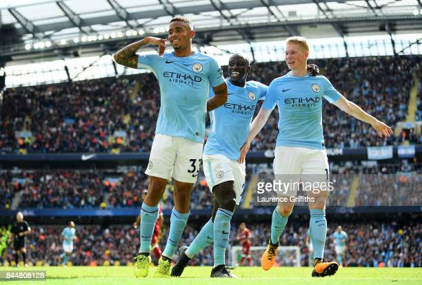 Gabriel Jesus of Manchester City celebrates scoring his sides second goal with Kevin De Bruyne of Manchester City and Benjamin Mendy of Manchester...