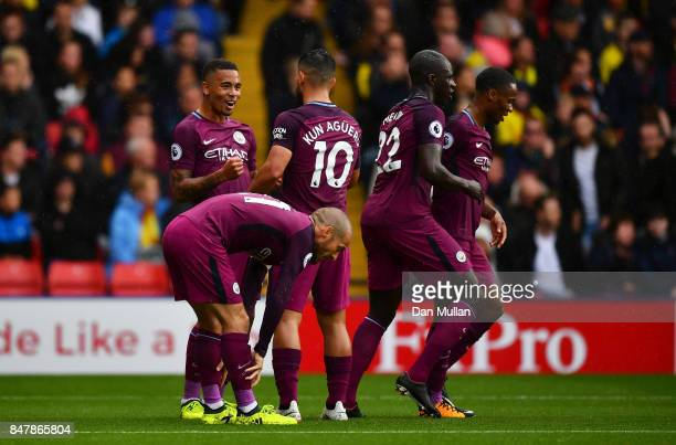 Gabriel Jesus of Manchester City celebrates scoring his sides third goal with Sergio Aguero of Manchester City and his team mates during the Premier...