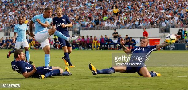 Gabriel Jesus of Manchester City fires a shot between Jan Vertonghen and Toby Alderweireld of Tottenham during the first half of the 2017...