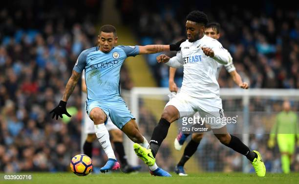 Gabriel Jesus of Manchester City holds off Leroy Fer of Swansea City during the Premier League match between Manchester City and Swansea City at...
