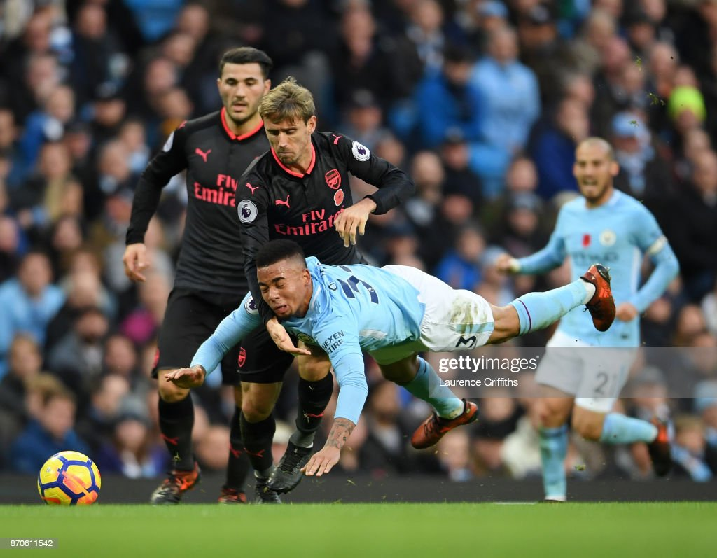 Gabriel Jesus of Manchester City is fouled by Nacho Monreal of Arsenal during the Premier League match between Manchester City and Arsenal at Etihad Stadium on November 5, 2017 in Manchester, England.