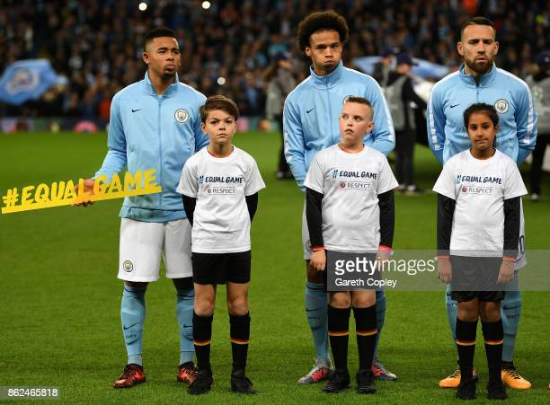 Gabriel Jesus of Manchester City Leroy Sane of Manchester City and Nicolas Otamendi of Manchester City pose for a photo with the player escorts prior...