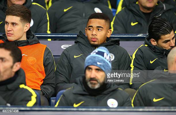 Gabriel Jesus of Manchester City looks on from his seat on the bench during the Premier League match between Manchester City and Tottenham Hotspur at...
