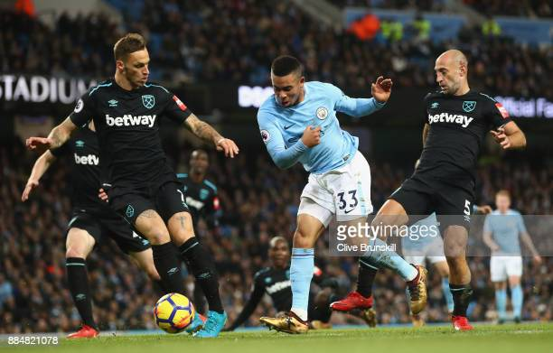 Gabriel Jesus of Manchester City Marko Arnautovic of West Ham United and Pablo Zabaleta of West Ham United battle for possession during the Premier...
