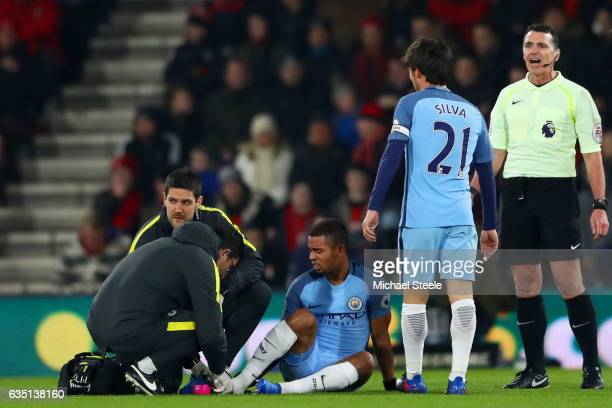 Gabriel Jesus of Manchester City receives treatment for an injury before being substituted during the Premier League match between AFC Bournemouth...
