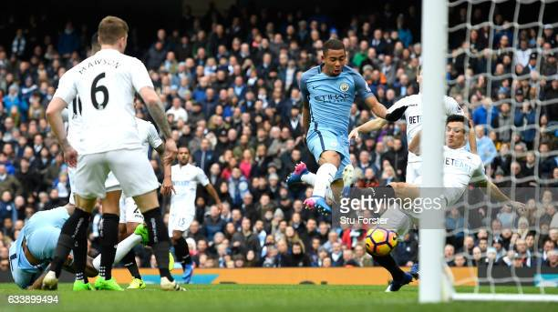 Gabriel Jesus of Manchester City scores his sides first goal during the Premier League match between Manchester City and Swansea City at Etihad...