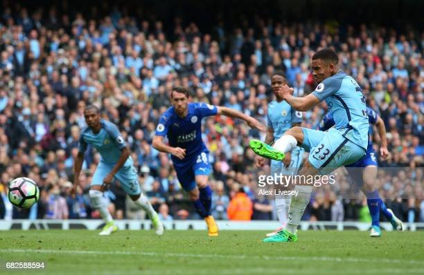 Gabriel Jesus of Manchester City scores his sides second goal from the penalty spot during the Premier League match between Manchester City and...