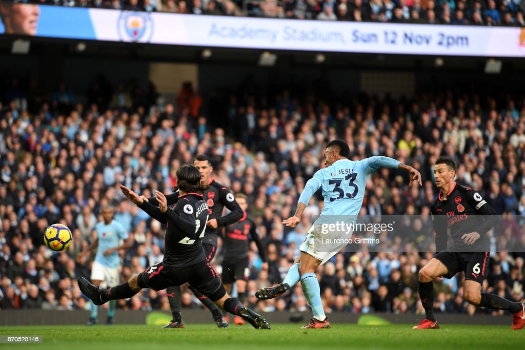 Gabriel Jesus of Manchester City scores his sides third goal during the Premier League match between Manchester City and Arsenal at Etihad Stadium on November 5, 2017 in Manchester, England.