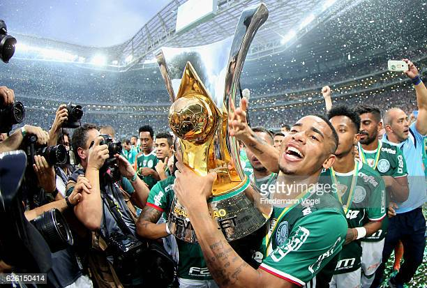 Gabriel Jesus of Palmeiras celebrates with the trophy after winning the match between Palmeiras and Chapecoense for the Brazilian Series A 2016 at...