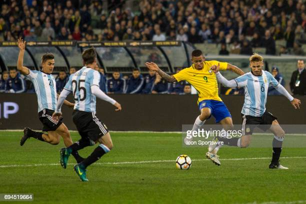 Gabriel Jesus of the Brazilian National Football Team controls the ball in front of Lucas Biglia of the Argentinan National Football Team Paulo...