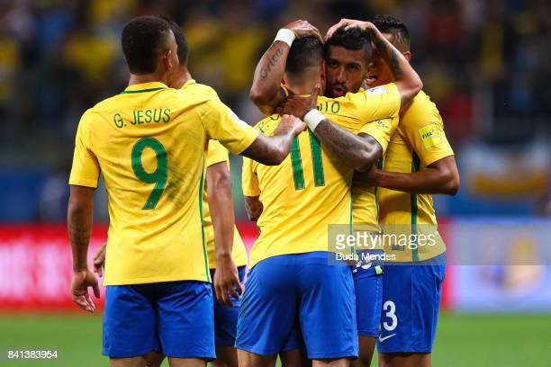 Gabriel Jesus Philippe Coutinho and Paulinho of Brazil celebrate a scored goal against Ecuador during a match between Brazil and Ecuador as part of...