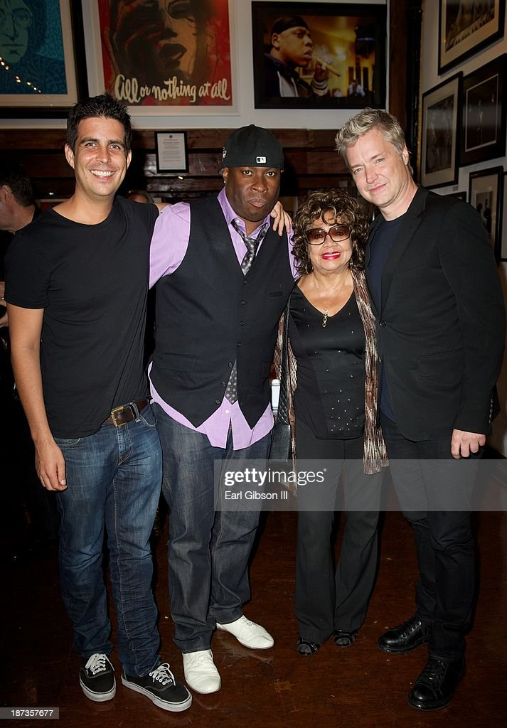 Gabriel Johnson, Vince Wilburn Jr., Frances Taylor and <a gi-track='captionPersonalityLinkClicked' href=/galleries/search?phrase=Chris+Botti&family=editorial&specificpeople=223897 ng-click='$event.stopPropagation()'>Chris Botti</a> attend the 'Miles Davis: The Collected Artwork' Launch Party at Mr. Musichead Gallery on November 7, 2013 in Los Angeles, California.