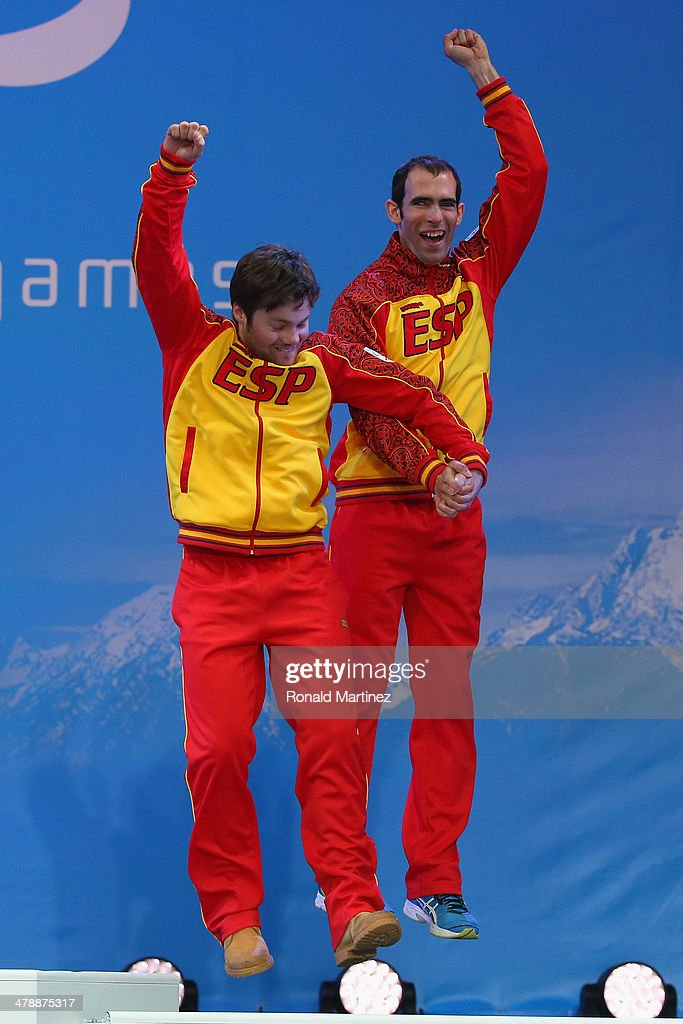 Gabriel Juan Gorce Yepes (R) of Spain and guide Josep Arnau Ferrer Ventura (L) celebrate at the medal ceremony for men's Super Combined Visually Impaired on day eight of the Sochi 2014 Paralympic Winter Games at Laura Cross-country Ski & Biathlon Center on March 15, 2014 in Sochi, Russia.