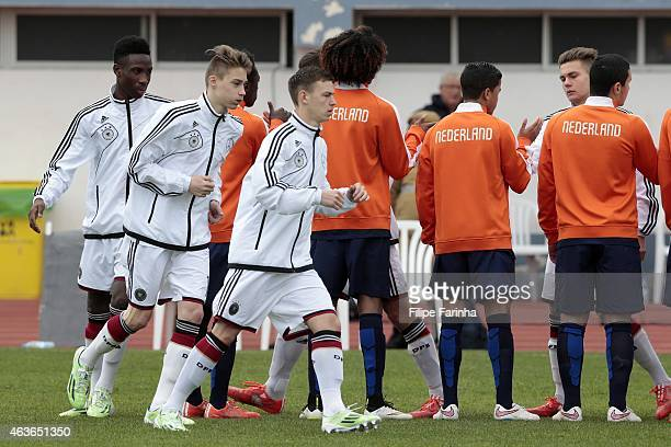 Gabriel Kyeremateng DavideJerome Itter and Dominik Wanner of Germany get prepared for the kickoff while both teams greet each during the U16 UEFA...
