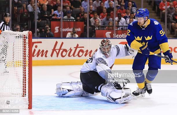 Gabriel Landeskog creates traffic in front of John Gibson of Team North America as Patrik Berglund of Team Sweden scores a third period goal during...