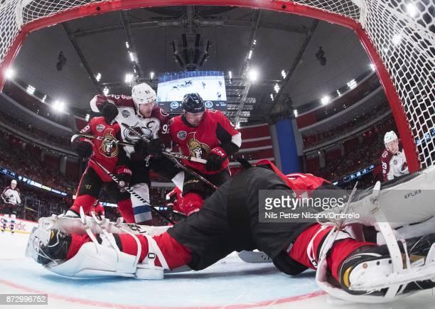 Gabriel Landeskog of Colorado Avalanche and Cody Ceci of Ottawa Senators during the 2017 SAP NHL Global Series match between Colorado Avalanche and...